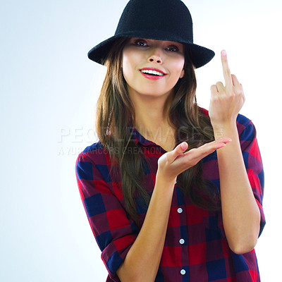 Buy stock photo Cropped shot of a young woman showing middle finger against a white background