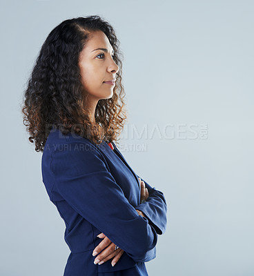 Buy stock photo Cropped profile of an attractive mature woman standing against a gray background in the studio during the day