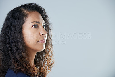 Buy stock photo Cropped studio shot of an attractive mature woman standing and looking away against a gray background