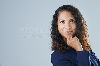 Buy stock photo Cropped portrait of an attractive mature woman posing with her hand on her chin while standing against a gray background