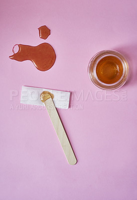 Buy stock photo Studio shot of various waxing tools against a pink background