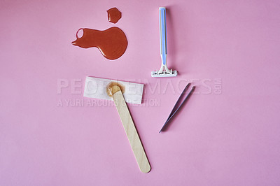 Buy stock photo Studio shot of various hair removal tools against a pink background