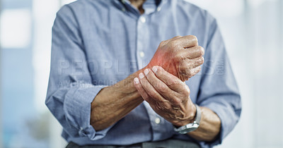 Buy stock photo Cropped shot of an unrecognizable man experiencing wrist pain