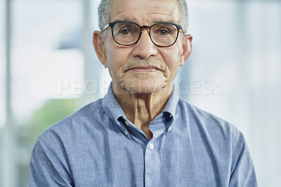 Buy stock photo Cropped shot of a senior man looking at the camera