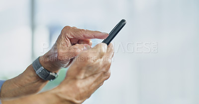 Buy stock photo Cropped shot of an unrecognizable senior man using a cellphone