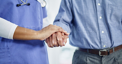 Buy stock photo Cropped shot of a nurse holding hands with a senior man