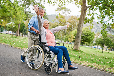 Buy stock photo Full length shot of a happy senior man pushing his overjoyed senior wife in a wheelchair in the park