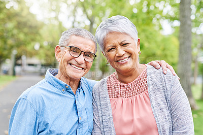 Buy stock photo Cropped portrait of an affectionate senior couple holding each other while in the park during the day