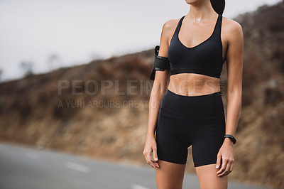 Buy stock photo Closeup shot of an unrecognizable young woman exercising outdoors