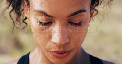 Buy stock photo Closeup shot of a sporty young woman out for a run