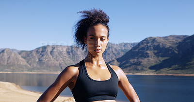 Buy stock photo Cropped shot of a sporty young woman looking determined while out for a run