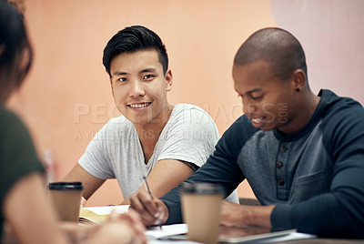 Buy stock photo Shot of a group of young men and women studying together outside on campus