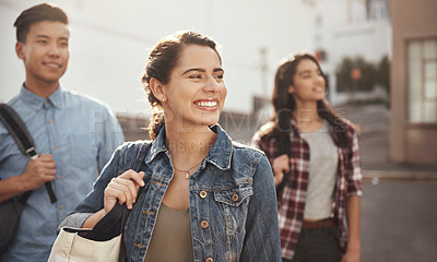 Buy stock photo Shot of a group of young college students walking through the city