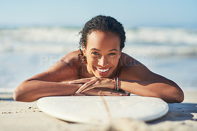 Buy stock photo Shot of a young woman out at the beach with her surfboard