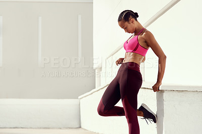Buy stock photo Shot of a young woman posing in sportswear while out for a workout