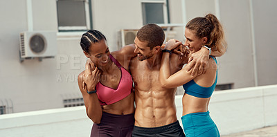 Buy stock photo Shot of a fitness group standing together while out for a workout