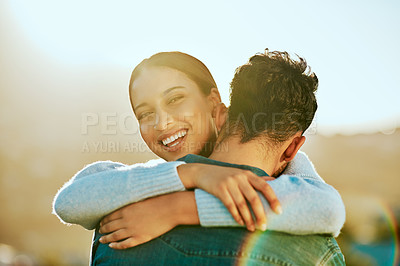 Buy stock photo Cropped shot of an affectionate couple spending the day outdoors