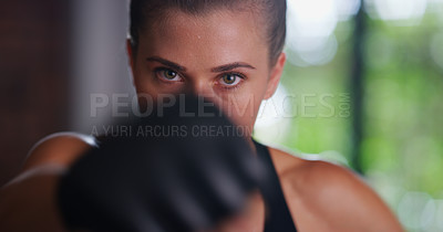 Buy stock photo Portrait of a beautiful young female kick boxer working out at the gym
