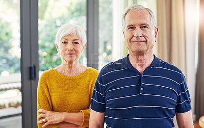 Buy stock photo Shot of a confident senior couple standing together at home