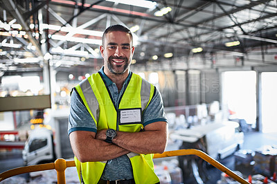 Buy stock photo Portrait of a warehouse worker standing with his arms crossed in a large warehouse