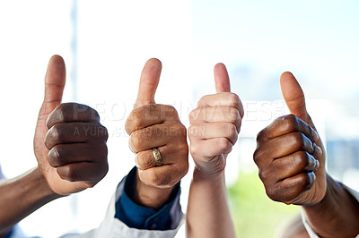 Buy stock photo Cropped shot of a group of unrecognizable medical practitioners showing thumbs up while standing in the hospital