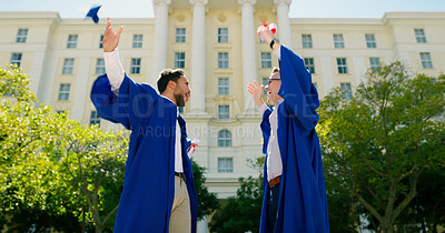 Buy stock photo Cropped shot of two handsome young friends celebrating together after graduation during the day
