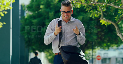 Buy stock photo Cropped shot of a handsome young businessman dancing alone outside while walking down the street during the day