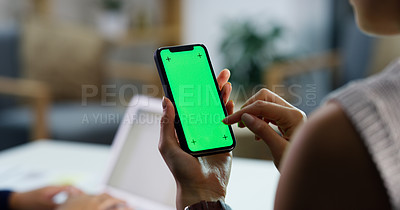 Buy stock photo Closeup shot of an unrecognisable businesswoman using a cellphone with a green screen in an office