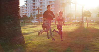 Buy stock photo Defocused shot of three sporty young women out for a run