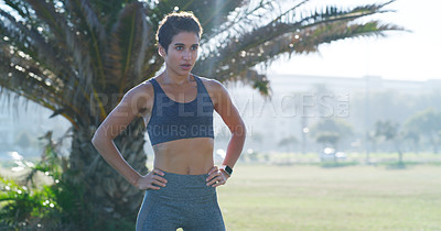 Buy stock photo Cropped shot of a young woman taking a break while out running