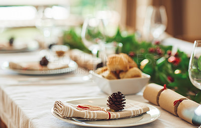 Buy stock photo Shot of a table setting at home during Christmas