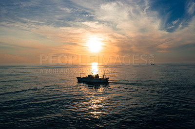 Buy stock photo Full length shot of a ship at sea during a sunset