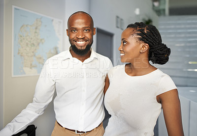 Buy stock photo Portrait of a happy young couple checking in at the reception of a hotel