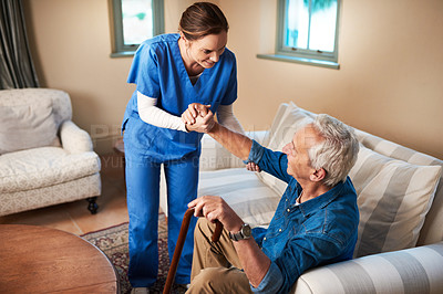 Buy stock photo Shot of a caregiver assisting her senior patient at home