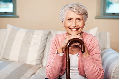 Buy stock photo Portrait of a senior woman sitting at home with a walking stick