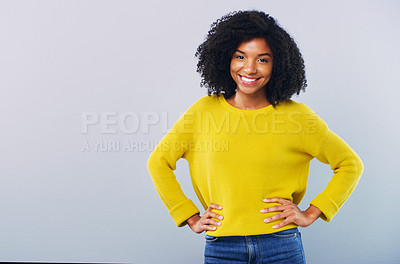 Buy stock photo Studio shot of a confident young woman posing against a grey background