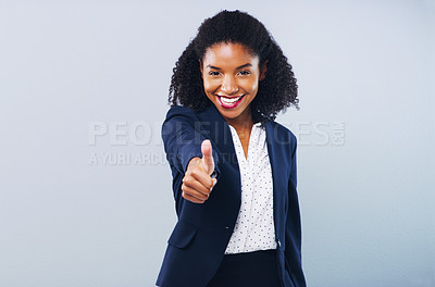 Buy stock photo Studio shot of an attractive young businesswoman giving thumbs up against a grey background