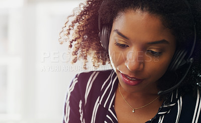 Buy stock photo Cropped headshot of an attractive young businesswoman wearing a headset while in the office during the day