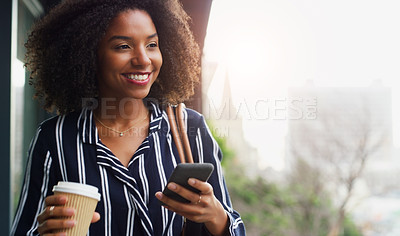 Buy stock photo Cropped shot of an attractive young businesswoman holding a coffee mug and using her cellphone while outside during the day