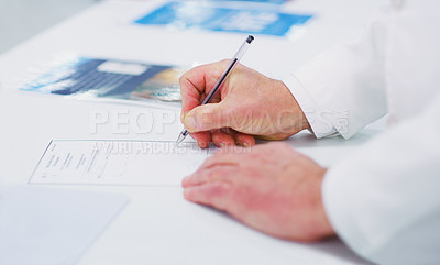 Buy stock photo Cropped shot of an unrecognizable pharmacist on a page
