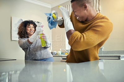 Buy stock photo Cropped shot of a playful couple having fun while cleaning