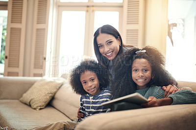 Buy stock photo Portrait of siblings using a digital tablet together while sitting with their mother