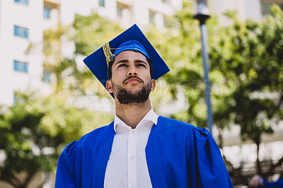 Buy stock photo Shot of a confident young man on graduation day