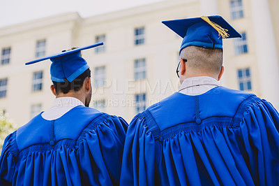 Buy stock photo Rearview shot of two young men on graduation