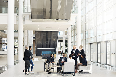 Buy stock photo Full length shot of a diverse group of businesspeople having a meeting while in the office during the day
