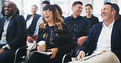 Buy stock photo Shot of a group of businesspeople laughing while attending a conference
