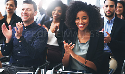 Buy stock photo Shot of a group of businesspeople clapping while attending a conference