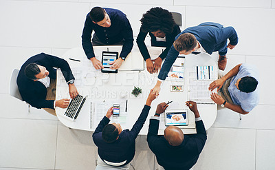 Buy stock photo High angle shot of a businessman and businesswoman shaking hands during a meeting in a modern office