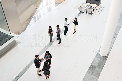 Buy stock photo High angle shot of businesspeople networking at a conference