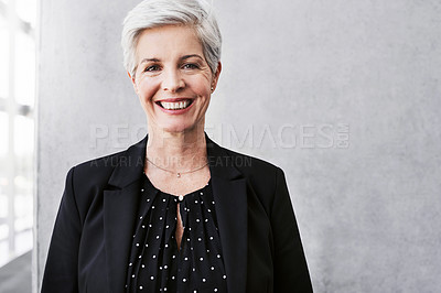 Buy stock photo Portrait of a confident mature businesswoman standing against a grey wall